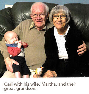 Carl with his wife, Martha, and their great-grandson.