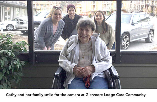 Cathy and her family smile for the camera at Glenmore Lodge Care Community.