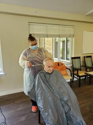 image of Diane giving a resident haircut