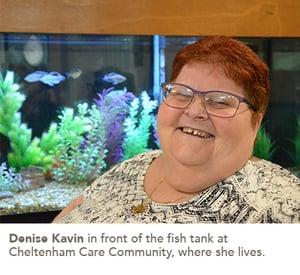 Denise Kavin in front of the fish tank at Cheltenham Care Community, where she lives.