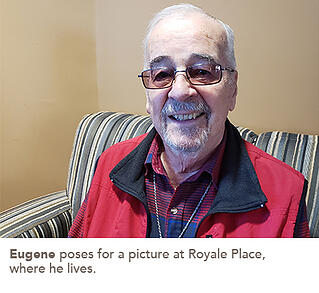 Eugene poses for a picture at Royale Place, where he lives.