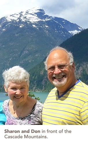 Sharon and Don in front of the Cascade Mountains