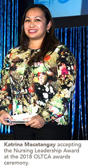 photo of Katrina Macatangay accepting the Nursing Leadership Award at the 2018 OLTCA awards ceremony.