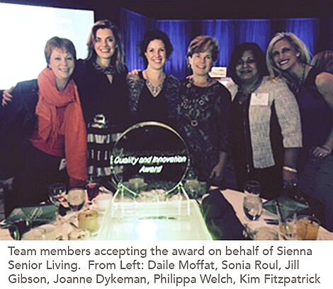 group photo of Sienna Senior Living's team members