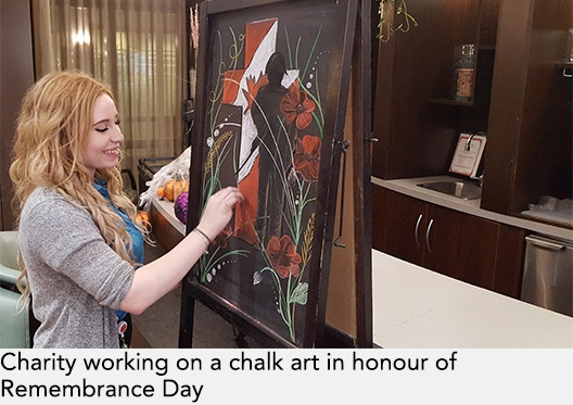 Charity working on a chalk art in honour of Remembrance Day