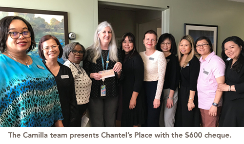 The Camilla team presents Chantel's Place with the $600 cheque.