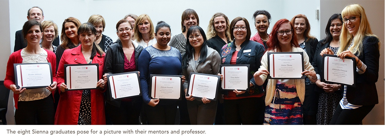 Picture of the Sienna graduates their mentors and professor