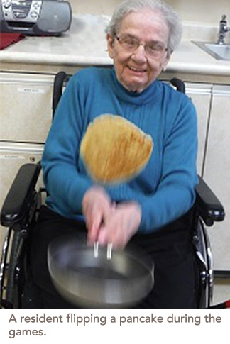 A resident flipping a pancake during the games
