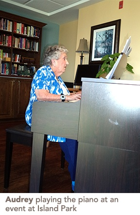 Audrey playing the piano at an event at Island Park