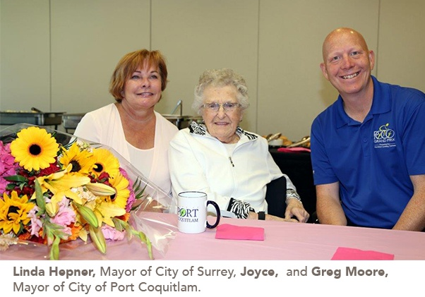 picture of Joyce with the 2 mayors