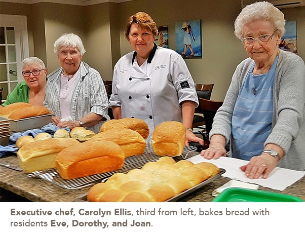 photo of executive chef, Carolyn Ellis and the residents who participated