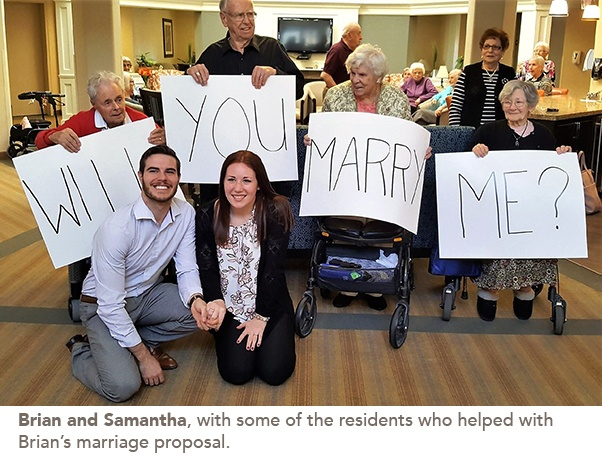 Photo of Brian and Samantha with some of the residents who helped with the marriage proposal