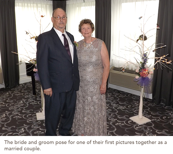 The bride and groom pose for one of their first pictures together as a married couple.