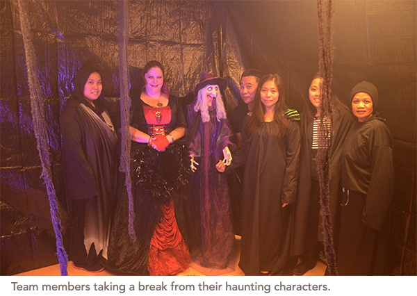 Team members taking a break from their haunting characters