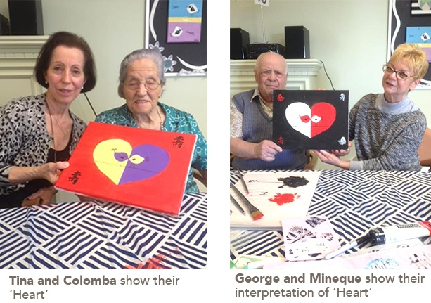 residents showing their paintings